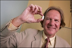 Prof Cosgrove holding a piece of non-stick chewing gum